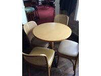 Substantial dining table and four chairs
