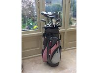 Trolley bag and golf clubs