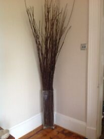 Large glass vase and wooden branches
