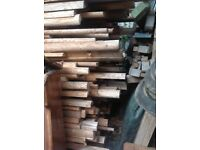 Large bundle of wooden half poles