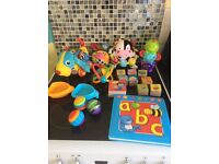 Collection of baby toys and books