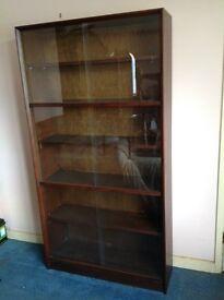 Large solid vintage book shelf with sliding glass partions