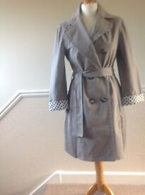 Coat to fit size 12. Italian design with unusual detail.