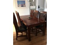 Dining table and 6 chairs, wood and faux leather.