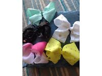 Official JoJo bows from Claire's. Used, but in good condition.