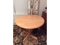 Round dropped leaf table as new light wood