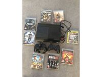 PlayStation 3 Slim with 2 controllers, remote and 8 games