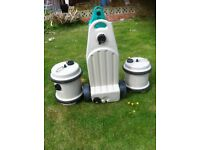 2 WATER BUTTS WITH ROLLER HANDLES AND A WHEELED WASTE WATER CONTAINER