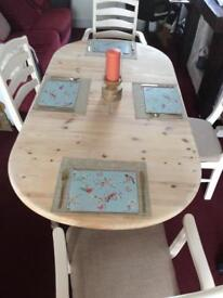 Refurbished solid pine table and 4 chairs (2 Carvers)