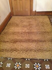 Large tan deep pile rug