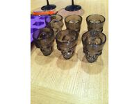 Halloween themed smokey coloured plastic skull shaped shot glasses: set of 6. more available