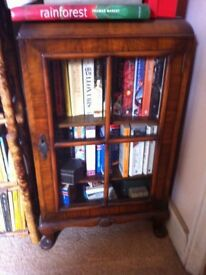 Late Victorian/Edwardian walnut, glass-fronted cabinet for sale.