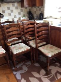 Large table and 6 chairs + matching dresser.