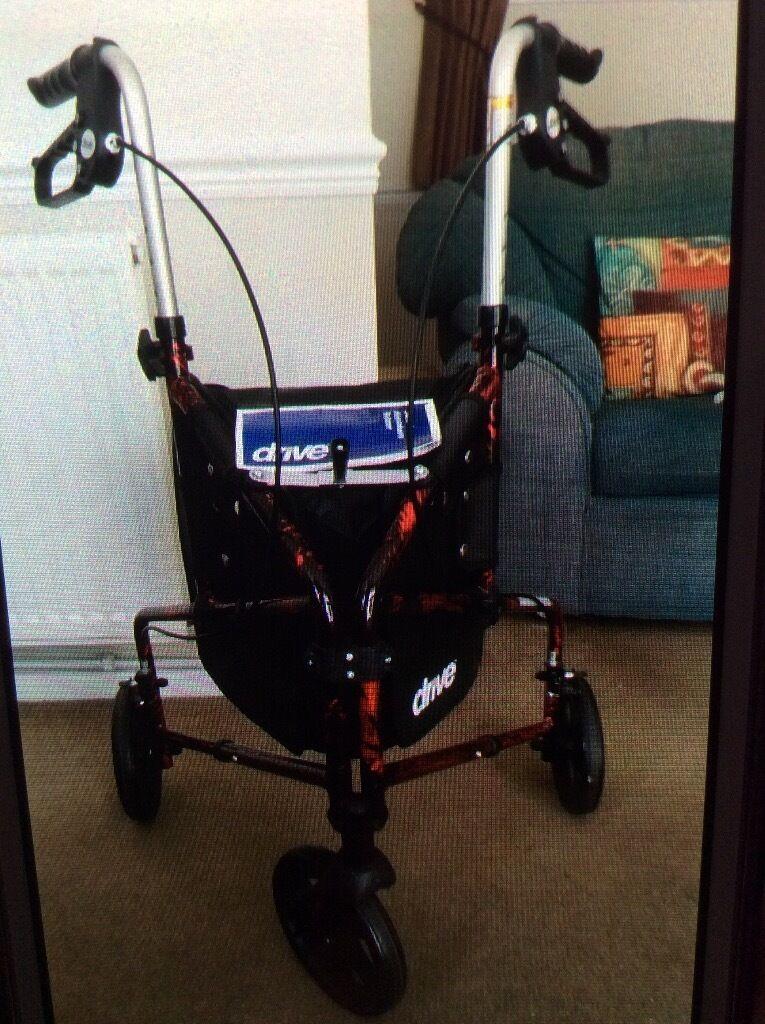 Lightweight Tri walker, loop handled brakes, Height adjustable handles, folds flat.