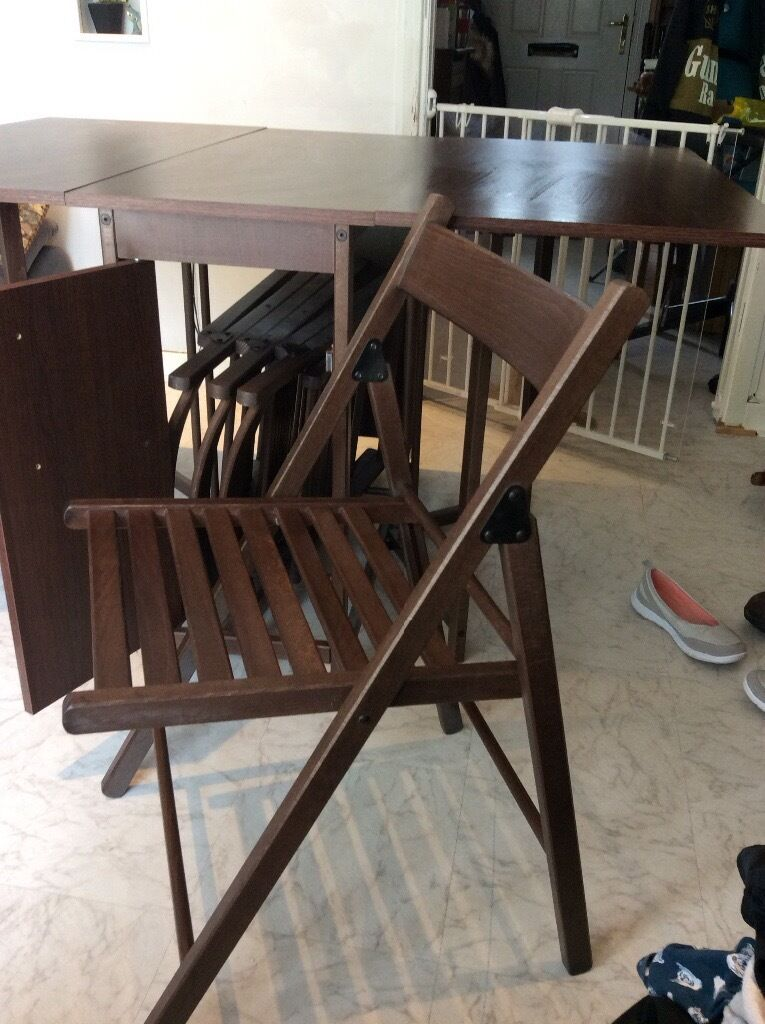 Perfect For Small Rooms Wooden Table Folds Out Chairs Stored Inside