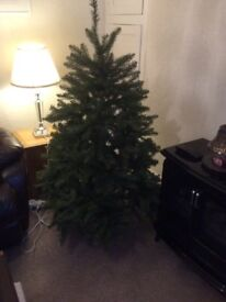 For sale Green artificial Xmas tree. Good quality 4ft6in from Haskins . Sale due to house move, £10