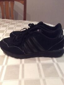 Adidas black trainers size 8.5 , in good condition all intact, worn but plenty of wear left.