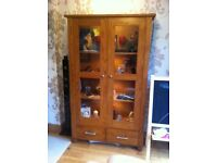 Oak glass front display cabinet with two draws