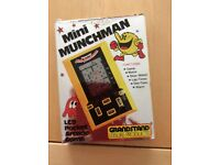 GRANDSTAND MINI MUNCHMAN HAND HELD GAME