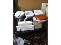 White toilet with seat and concealed cistern