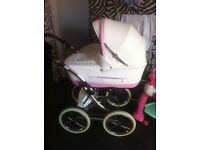 Pink and white leather pram