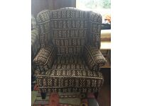 Dark brown and cream winged armchair.