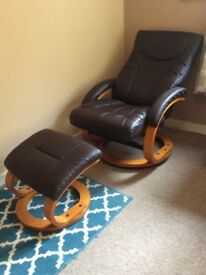 Brown leather reclining chair and footstool