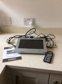 Visual flip down tv with remote and instruction book.GWO