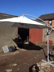 Commercial parasol with stand