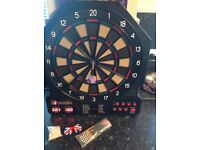 Electronic Dart Board rarely used. Comes with mains lead, darts and tips to start right away.