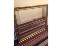 Mirror - Bevelled edge and silvered glass - brass coloured frame