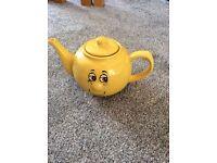yellow face tea pot