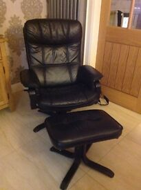 Black leather swivel/recliner armchair with footstool
