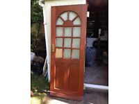 External hardwood half panelled door