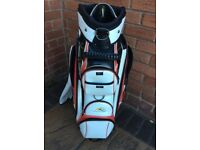 Power caddie golf bag as new. Red and white. Rain proof club cover.