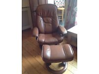 Tan leather Stressless armchair and matching footstool