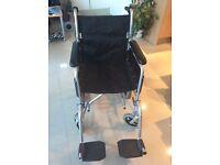 Black folding lightweight wheel chair by Angel mobility -Wick BS30