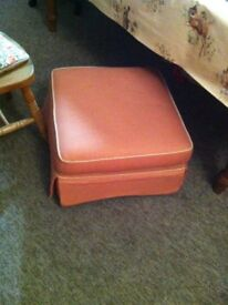 Salmon pink upholstered pouffe pouf footstool on wheels, London SW6 comfortable
