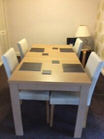 REDUCED FOR QUICK SALE EXTENDING DINING TABLE