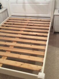 Solid white wooden double bed frame