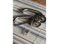 Pair of brushed stainless steel door handles