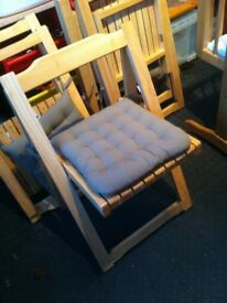 Wooden chairs which fold up. Very handy and in good condition.