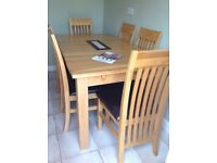 Oak solid dining room table extendable with six brown leather seat chairs