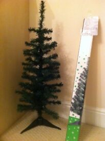 Three 3 foot artificial Christmas tree in green with stand.