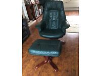 Green leather reclining chair and footstool .