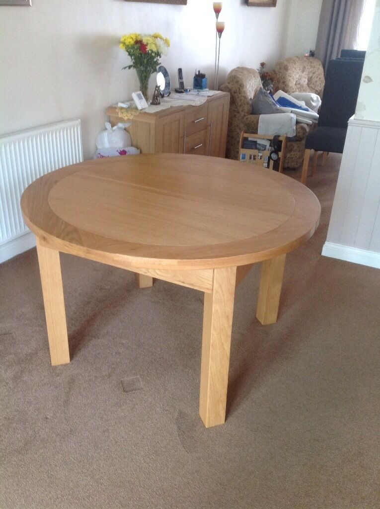 Light oak round extendable dinning table