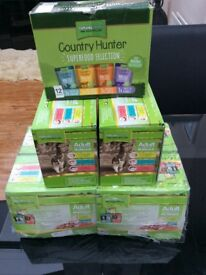 7 multi pack boxes of natures menu cat food. Each box contains 12 pouches various flavours