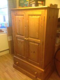 Wardrobe: pine wood,double doors, draw below and internal rail.