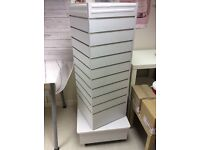 Rotating Slatboard stand, four sides 1200x405 overall height 1500. Good condition and on castors
