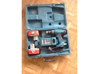 Makita cordless drill, 2 batteries, charger, carry case